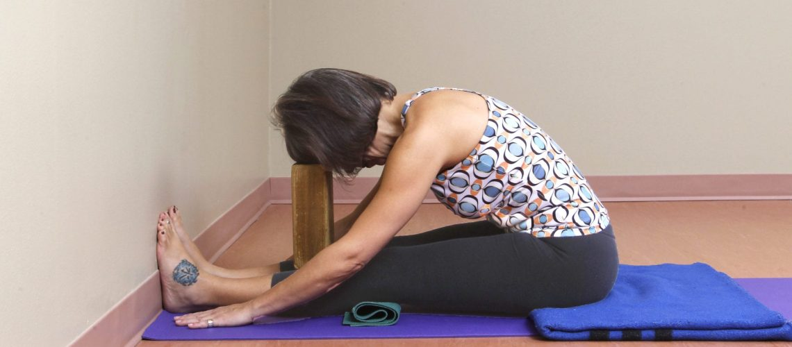 Paschimottanasana H feet to wall 157